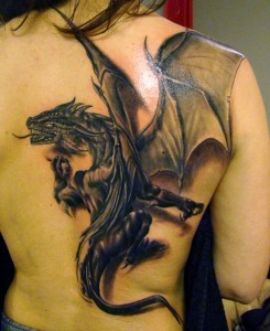 black and grey dragon tattoo with wings