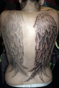 Black and grey angel wings tattoo