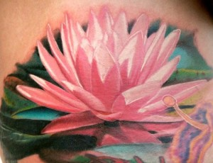 pink lotus flower tattoo done in realism